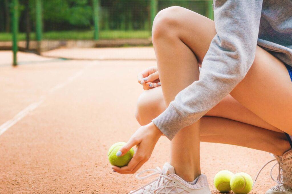 Tennis speelster op de Rhijenhof